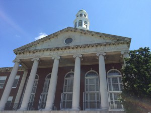Image of Trenton Central High School central portico taken in July 2014 showing the collonade, dentil molding, Palladian window and top of the clock tower.