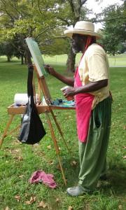 SiriOm Singh painting en plein air.