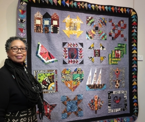 Mada Coles Gallowaywith her quilt African Crossings Home